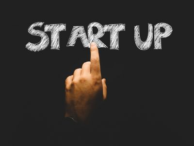 Image of finger pointing at the phrase start up
